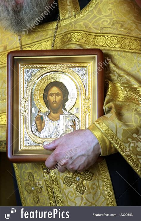 Picture Of Priest With Icon Jesus Christ
